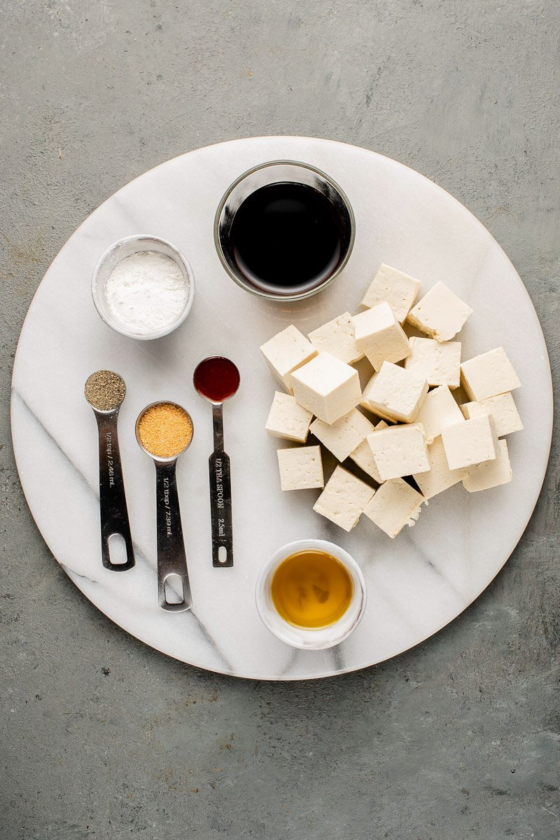 overhead image of ingredients for crispy baked tofu on white plate