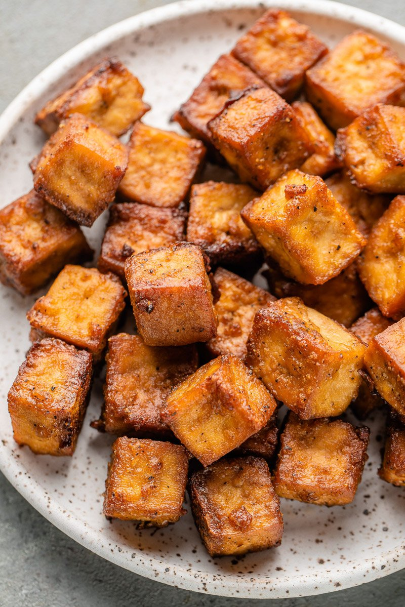 crispy baked tofu on a white speckled plate