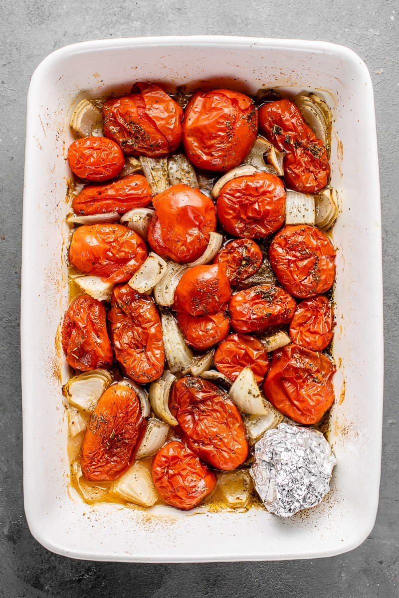 roasted tomatoes and onions in a casserole dish