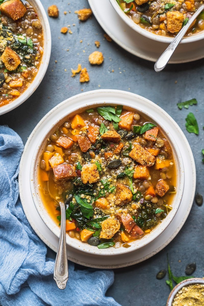overhead image of sweet potato lentil soup with spoon