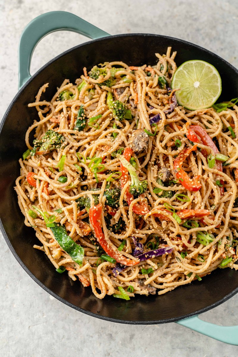 overhead image of wok filled with easy vegetable stir fry with peanut sauce