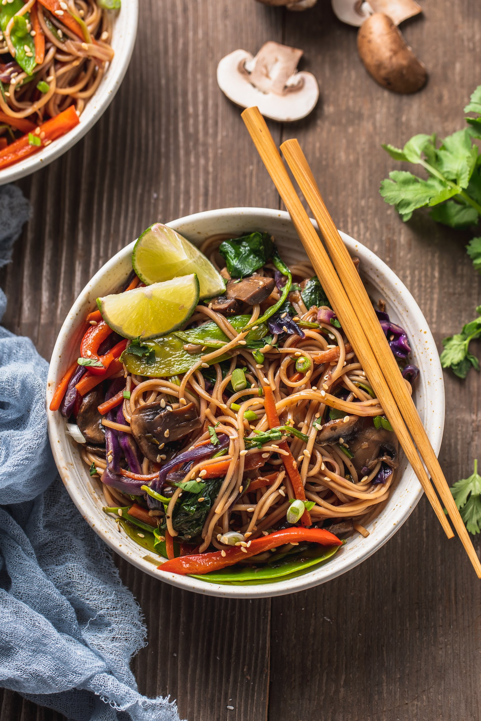 overhead image of bowl filled with stir fry and chop sticks on the side