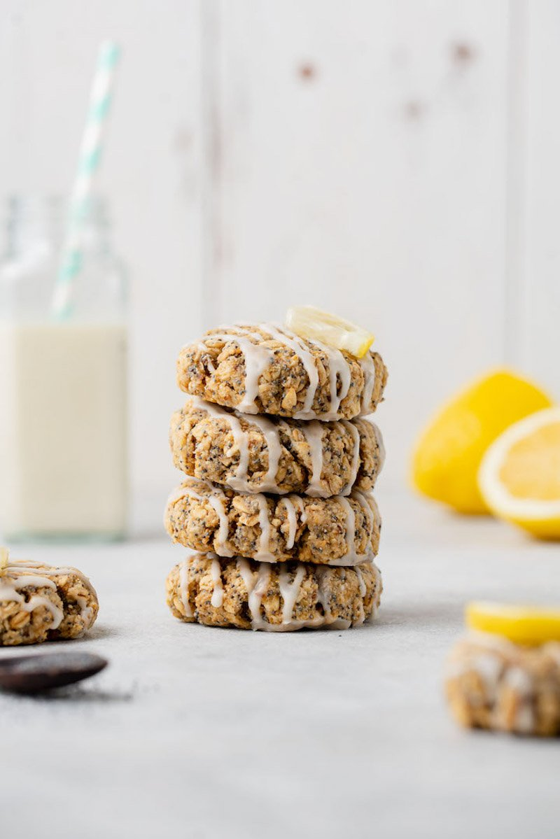 macro image of stacked lemon poppyseed cookies on white styled background
