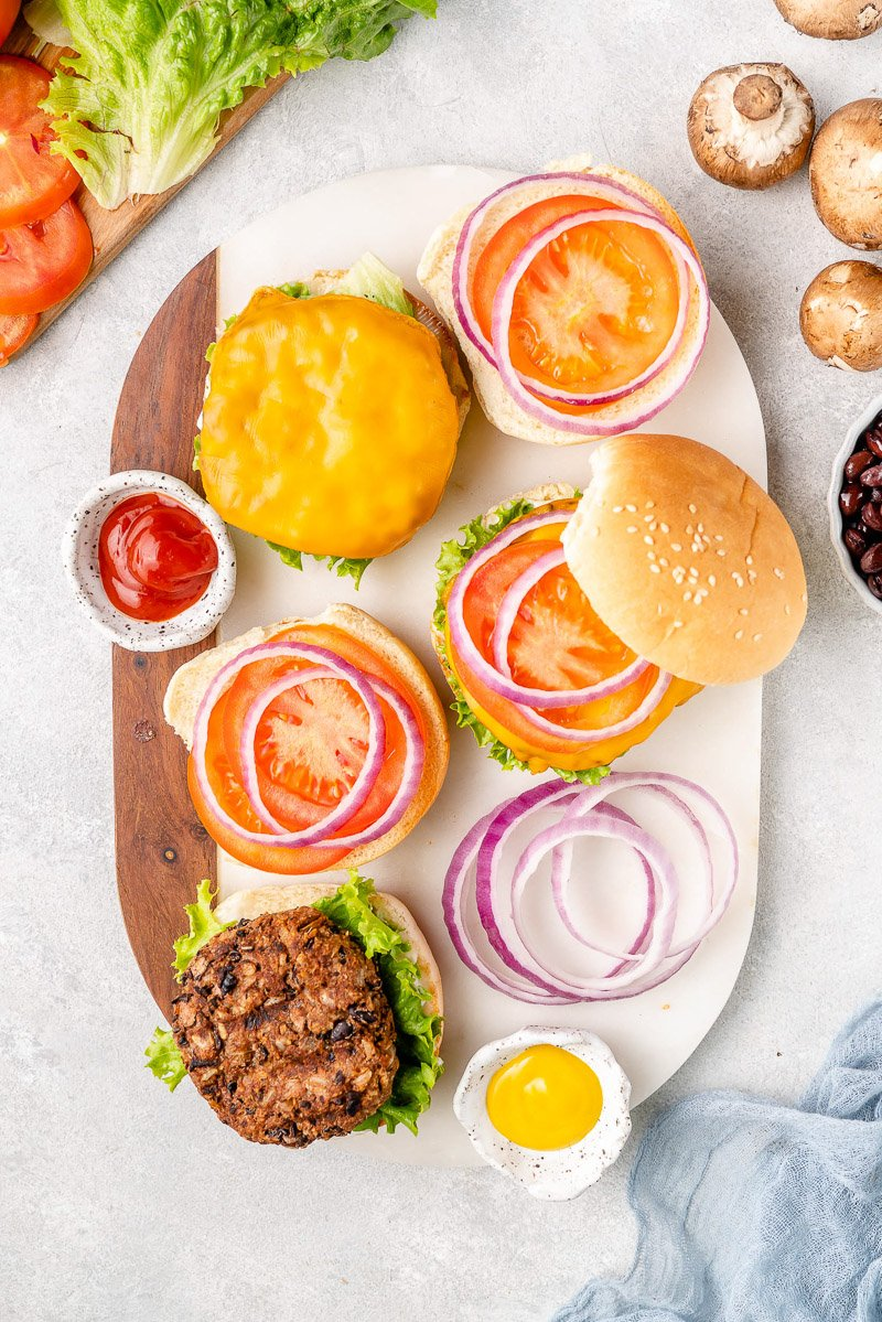 overhead image of burgers on a white tray
