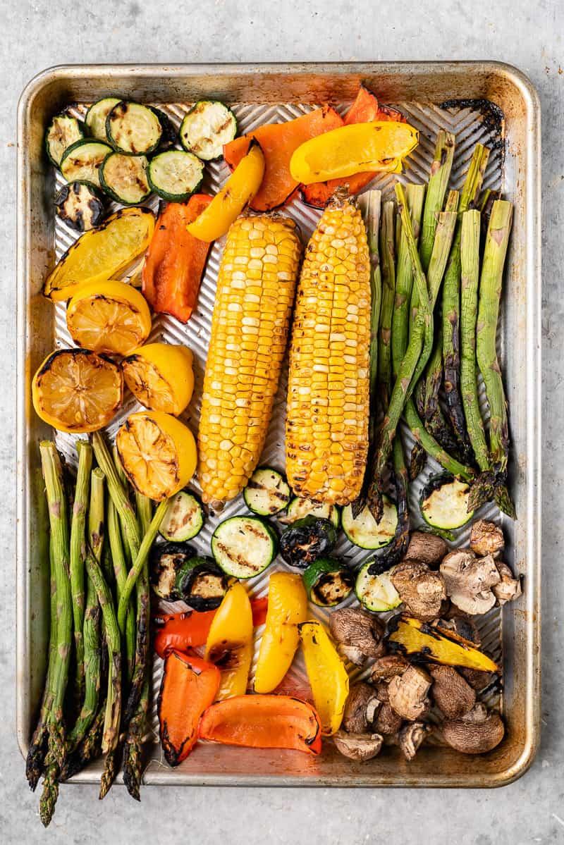 overhead image of grilled vegetables on baking sheet