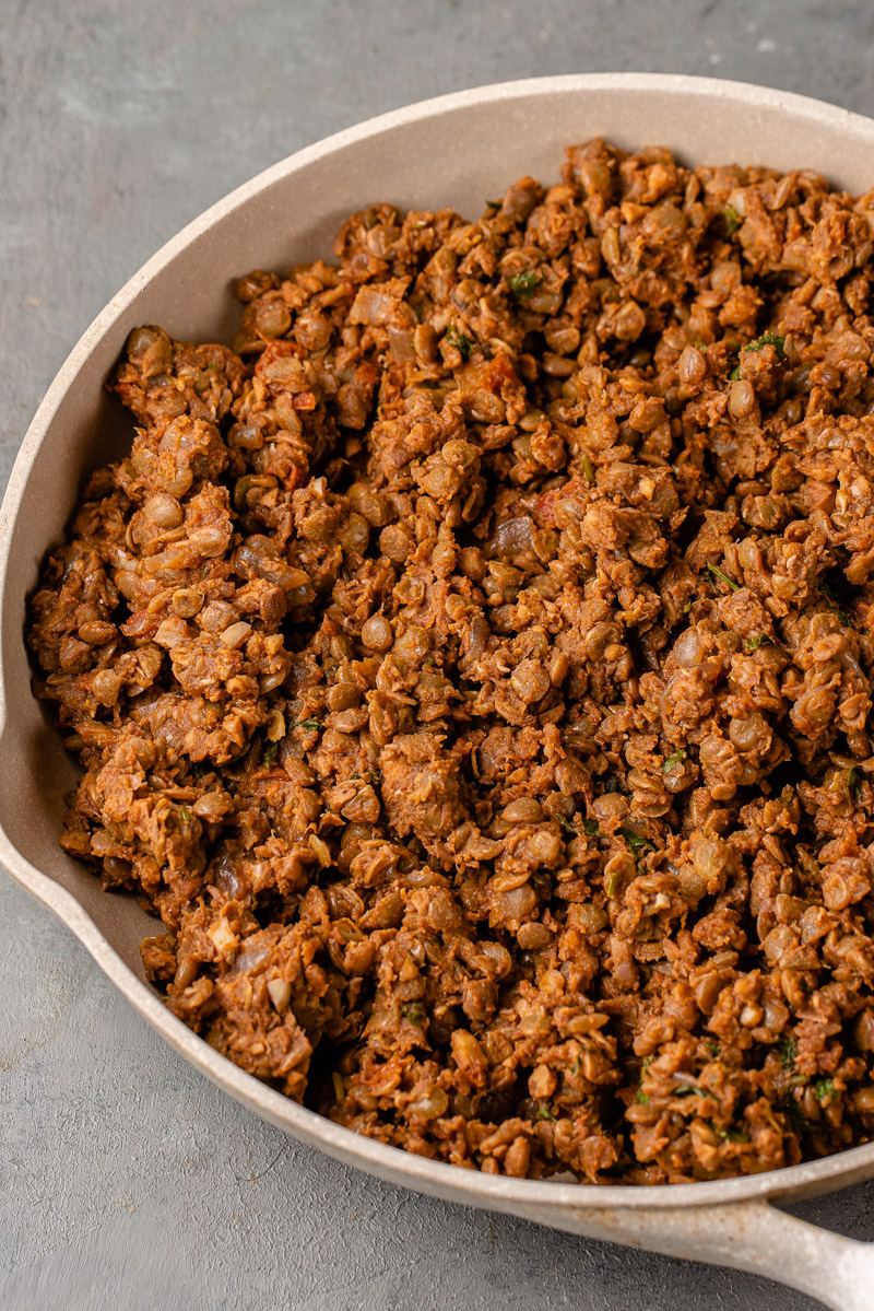 overhead macro image of lentil and walnut taco meat in a pan