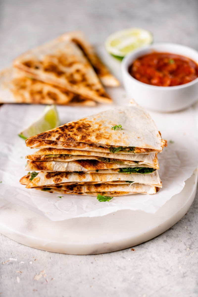 stacked slices of potato and bean quesadillas