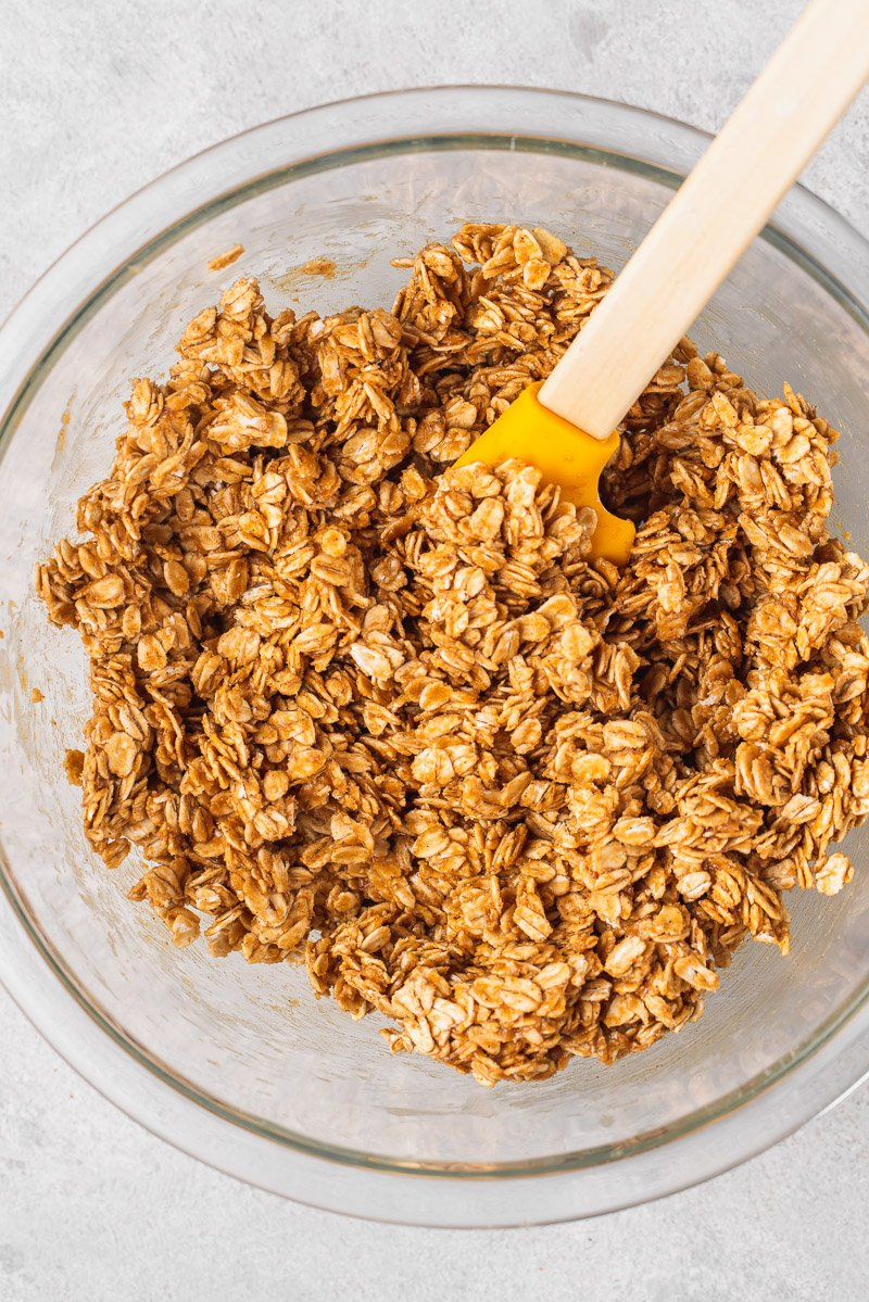 Overhead image of bowl of granola with spatula by sweetsimplevegan