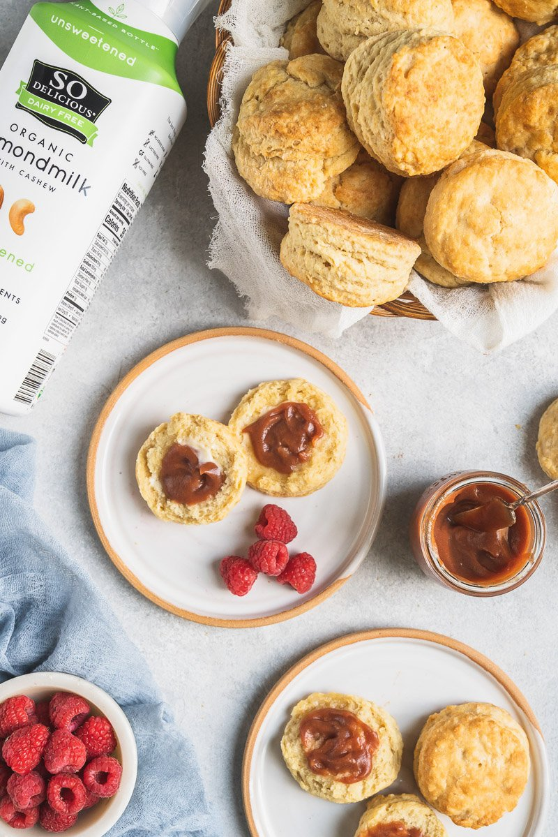 cut vegan buttermilk biscuits on plates with apple jam