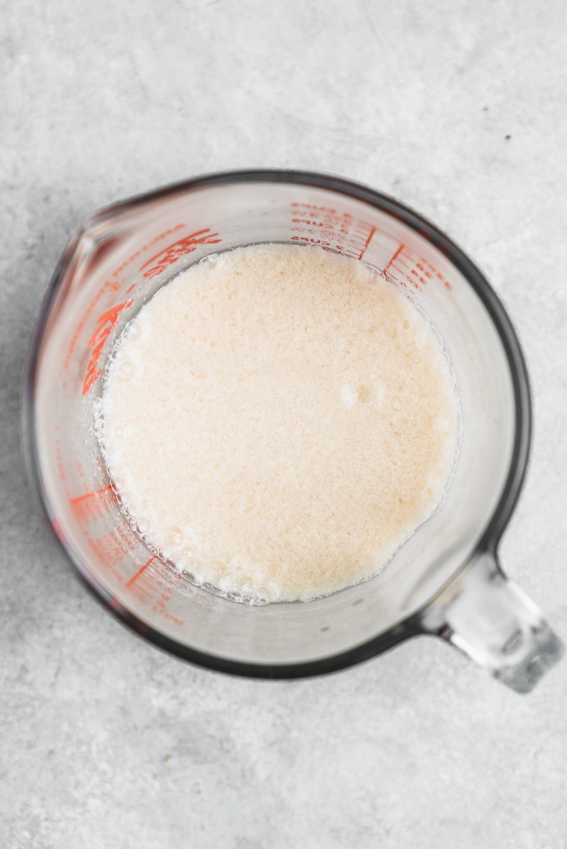 vegan buttermilk curdled in a glass measuring cup