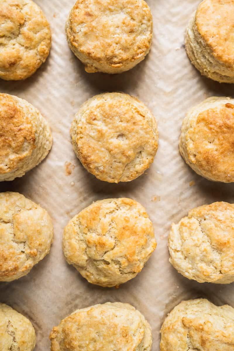 Fresh vegan buttermilk biscuits on a baking sheet