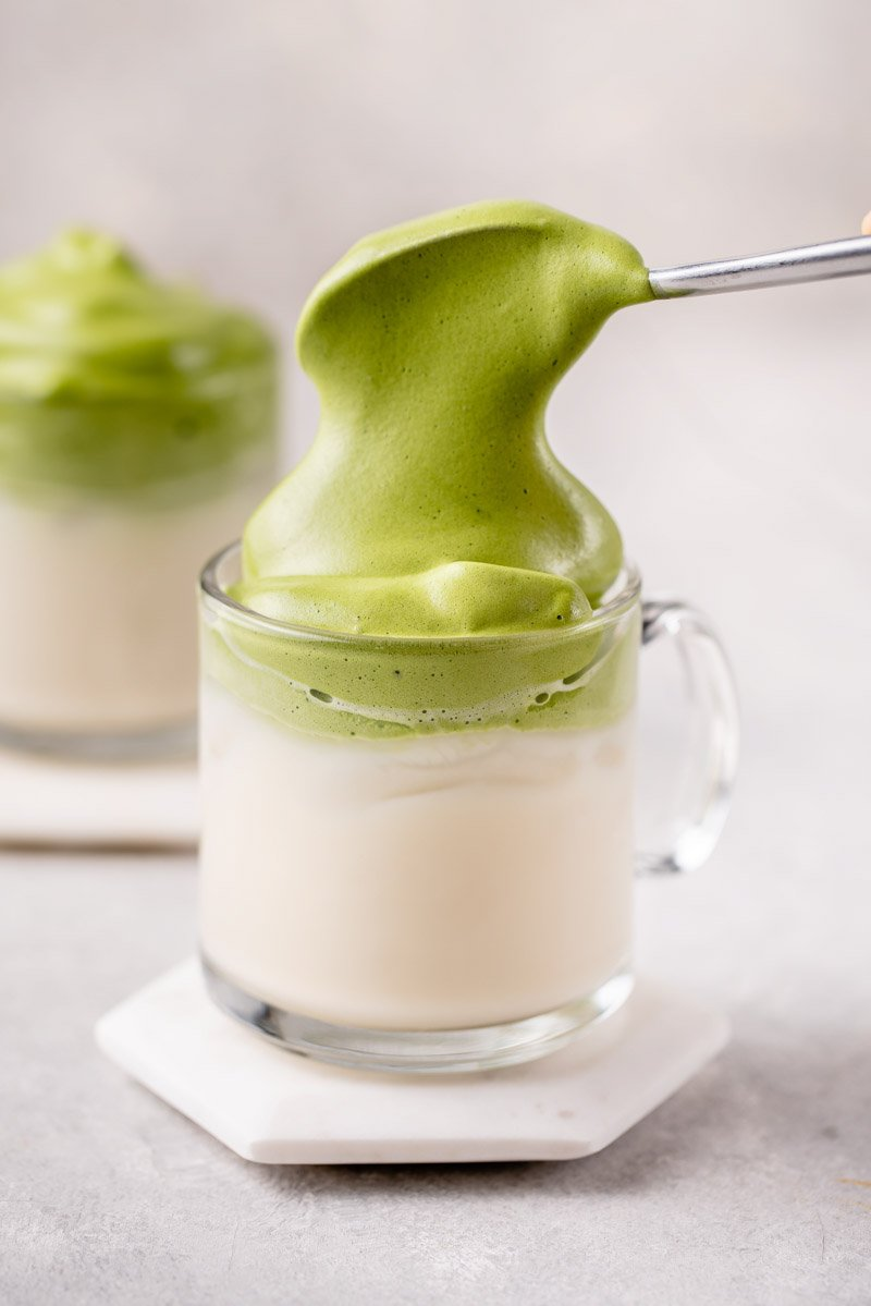 straight forward macro image of dalgona matcha latte with spoon