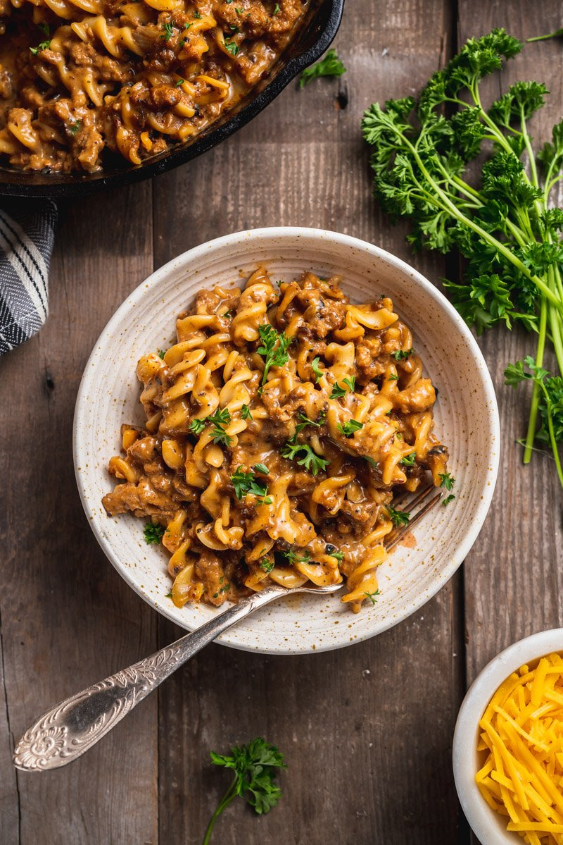 overhead image of one pot vegan hamburger helper in a bowl with fork