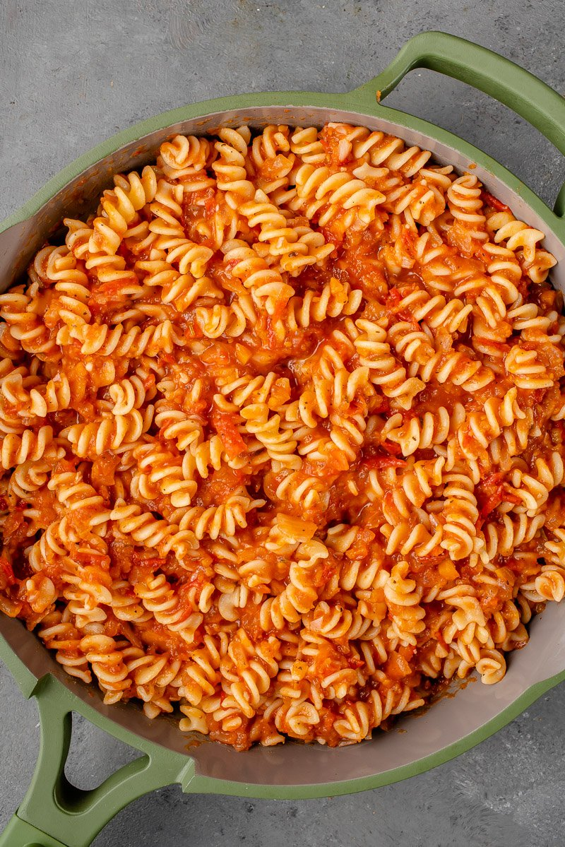 rigatoni pasta with red sauce in an our place always pan