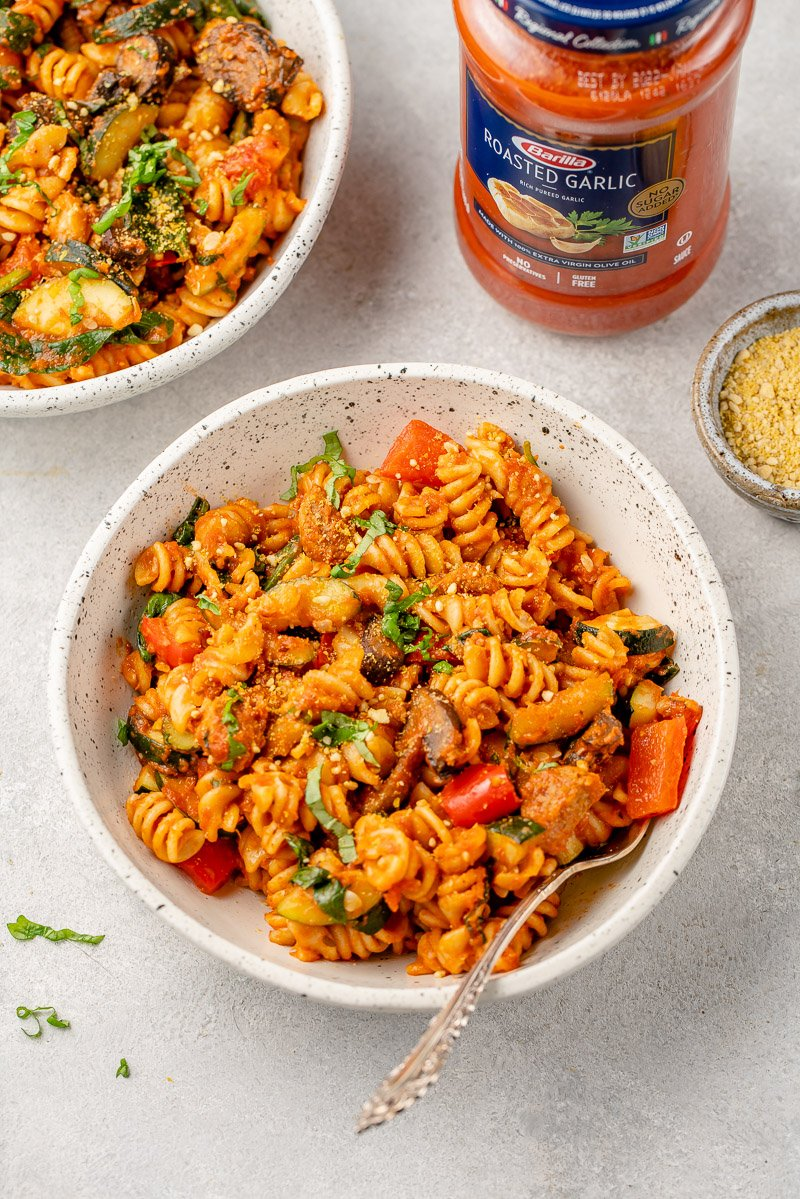 roasted vegetable pasta in a white ceramic bowl