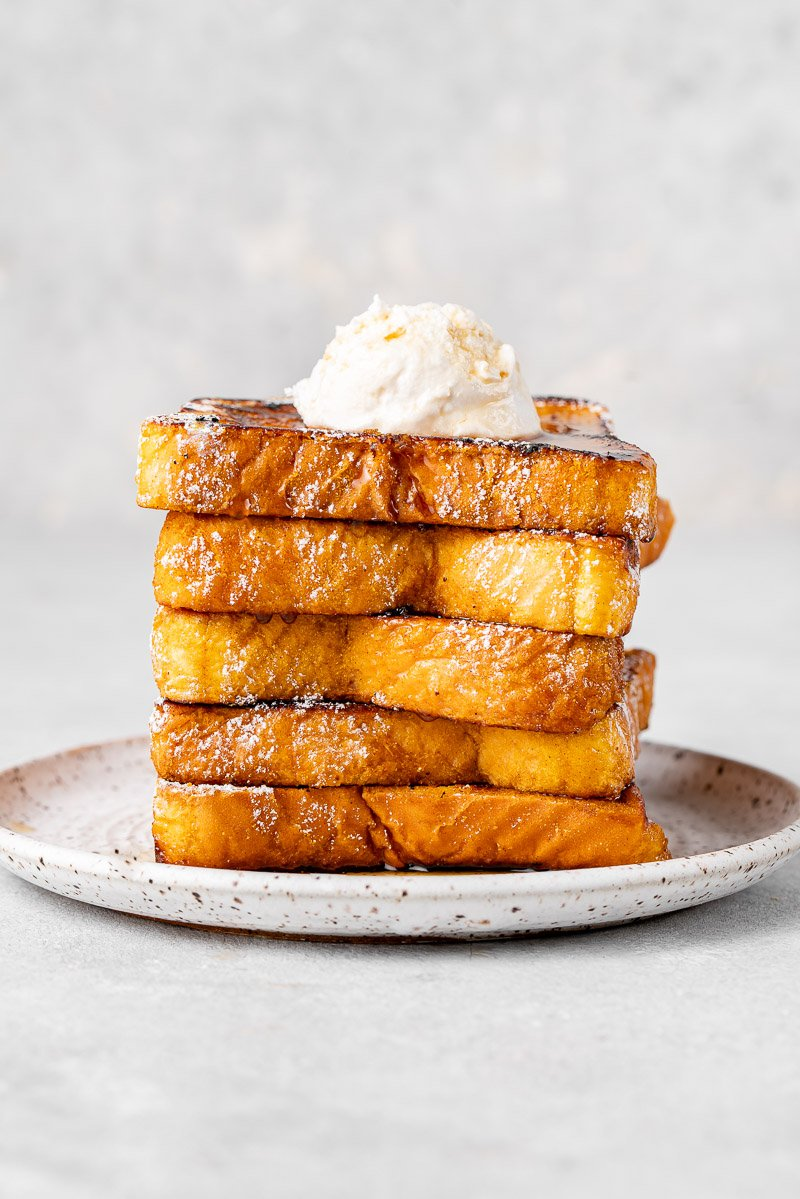 a stack of french toast with whipped cream