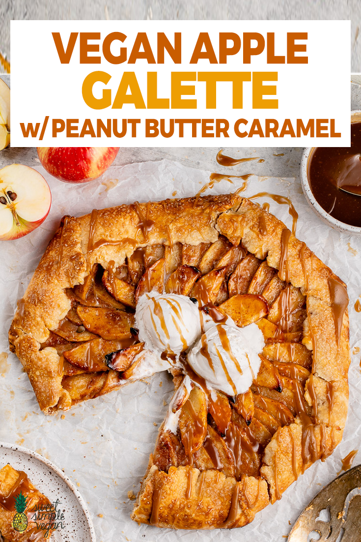 sliced vegan apple galette with vanilla ice cream and caramel sauce on a white board for pinterest