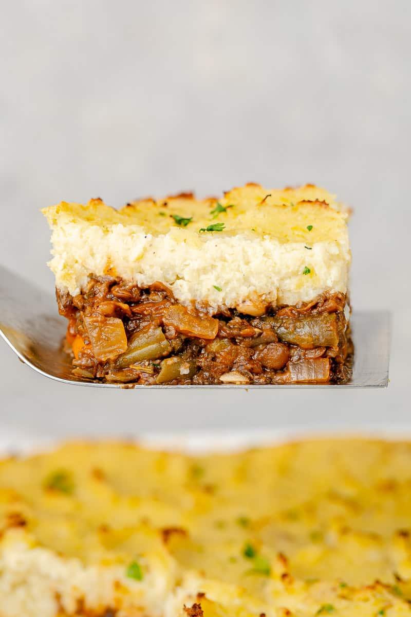 macro image of shepherd's pie slice lifted on spatula
