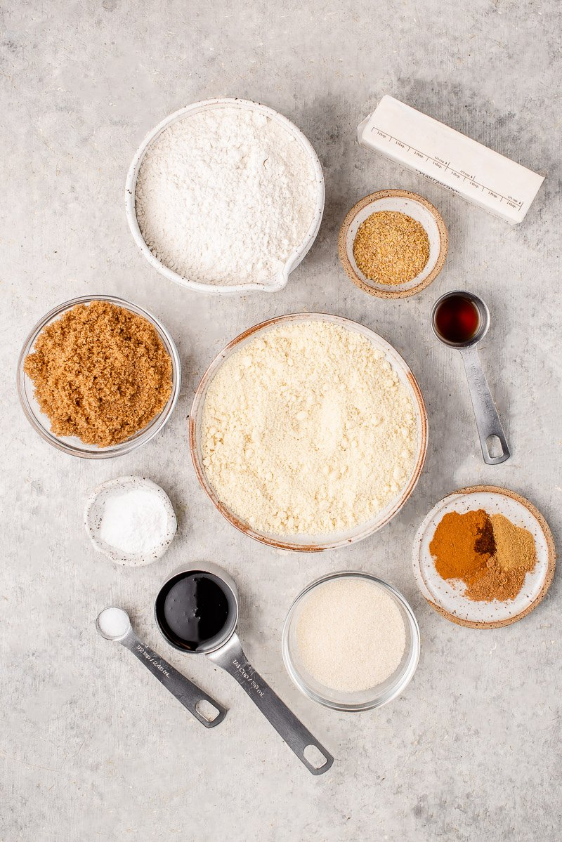 ingredients for ginger molasses cookies laid out on white board