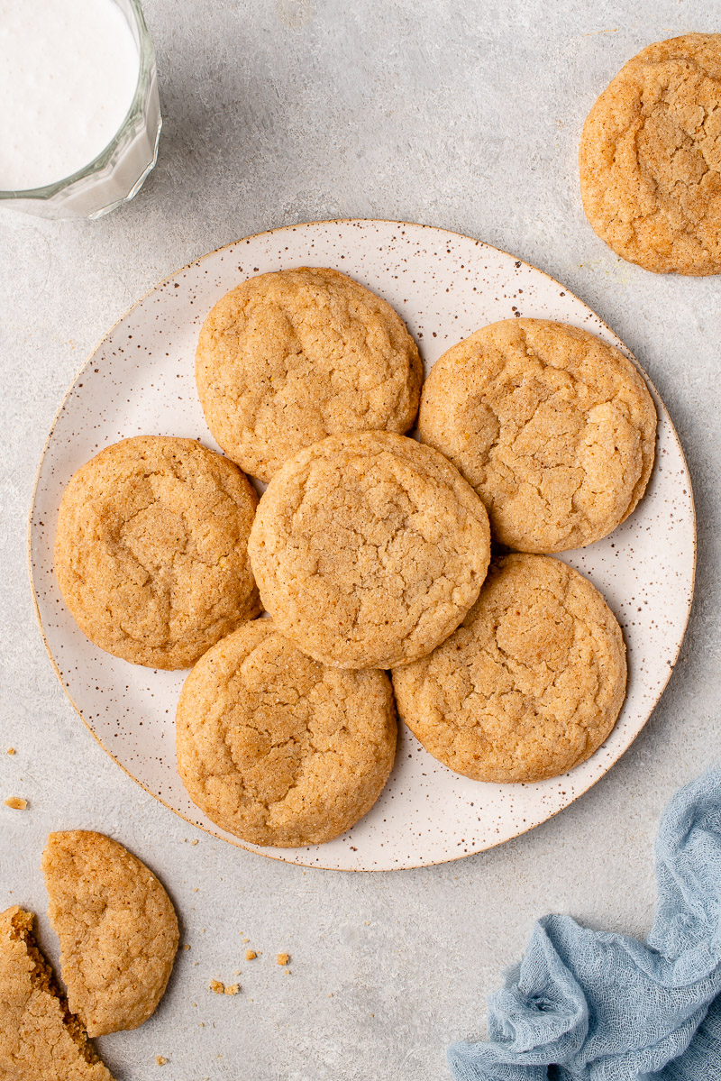 a white speckled plate with vegan eggnog snickerdoodle cookies