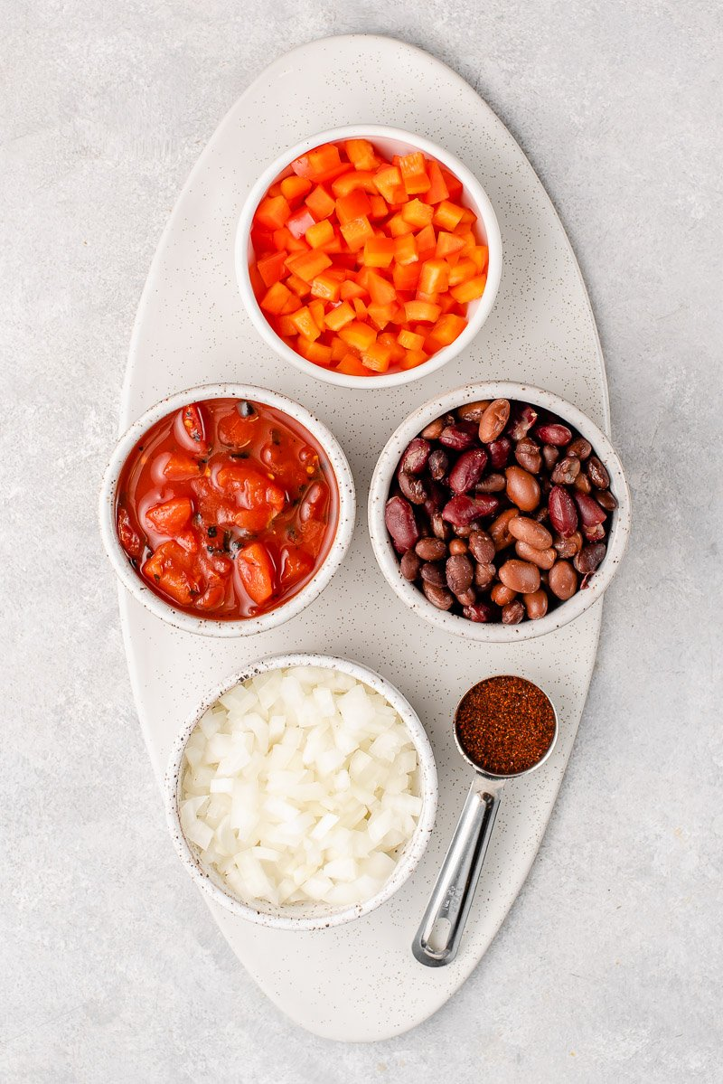 ingredients for vegan chili in small bowls