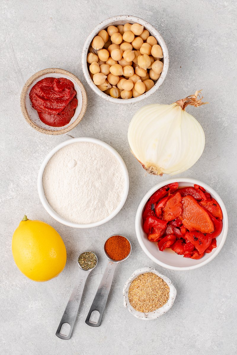 ingredients for chickpea burgers on a white board