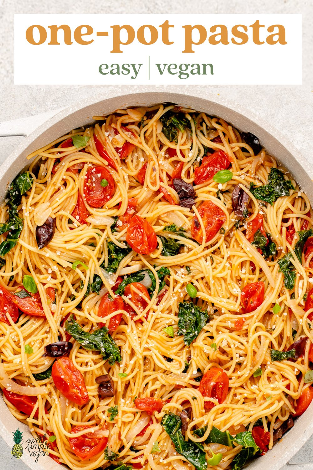 vegan pasta in a pot with tomatoes, kale, olives, basil and parmesan for pinterest