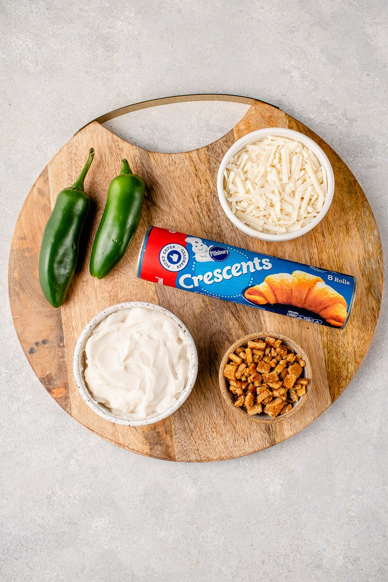 round wooden board with ingredients for vegan Jalapeño Popper Rolls
