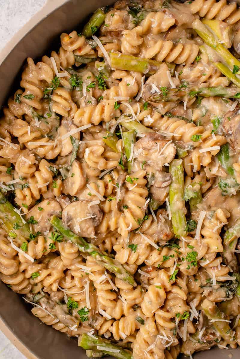 macro image of creamy one pot pasta topped with vegan parmesan