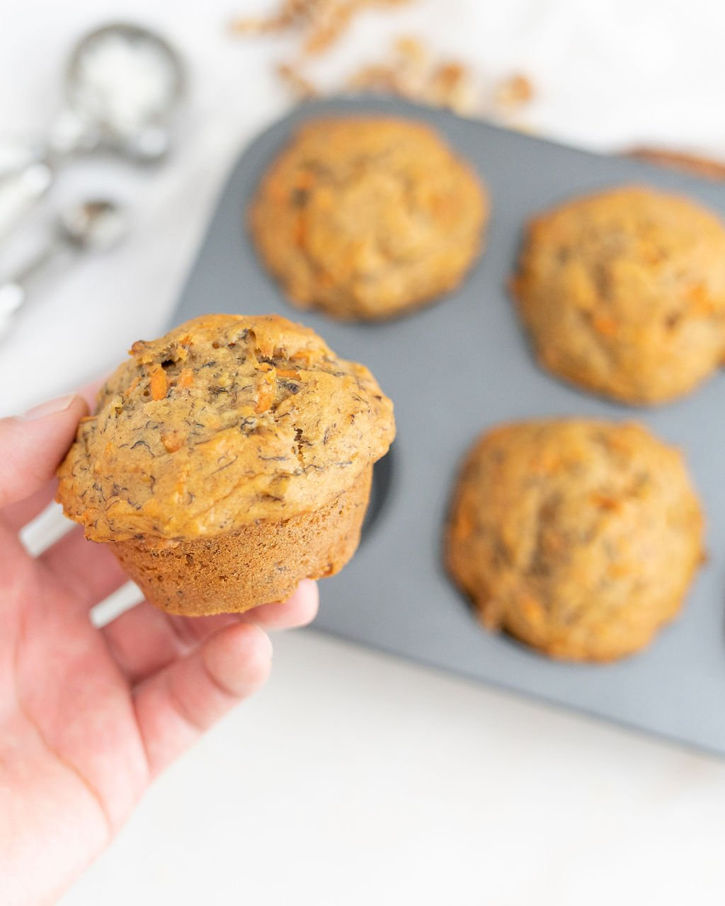 carrot cake muffins held in hand.