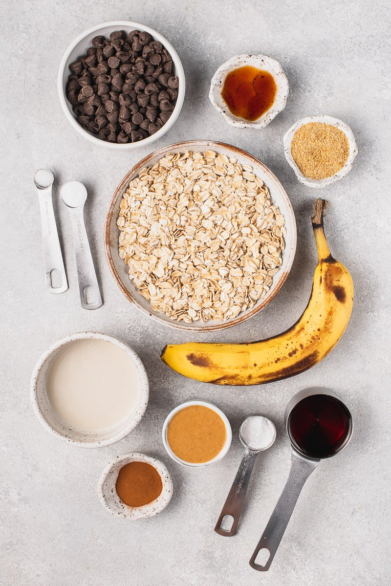 ingredients for chocolate chip baked oatmeal on a gray board
