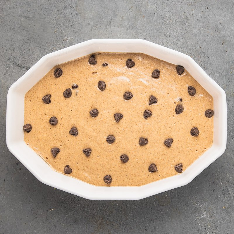 a photo of vegan baked oatmeal with chocolate chips on top before going into the oven