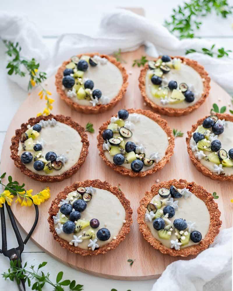 overhead image of lemon cheesecake tartlets.