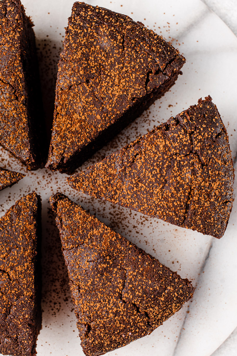 overhead image of chocolate soufflé cake dusted with coca powder
