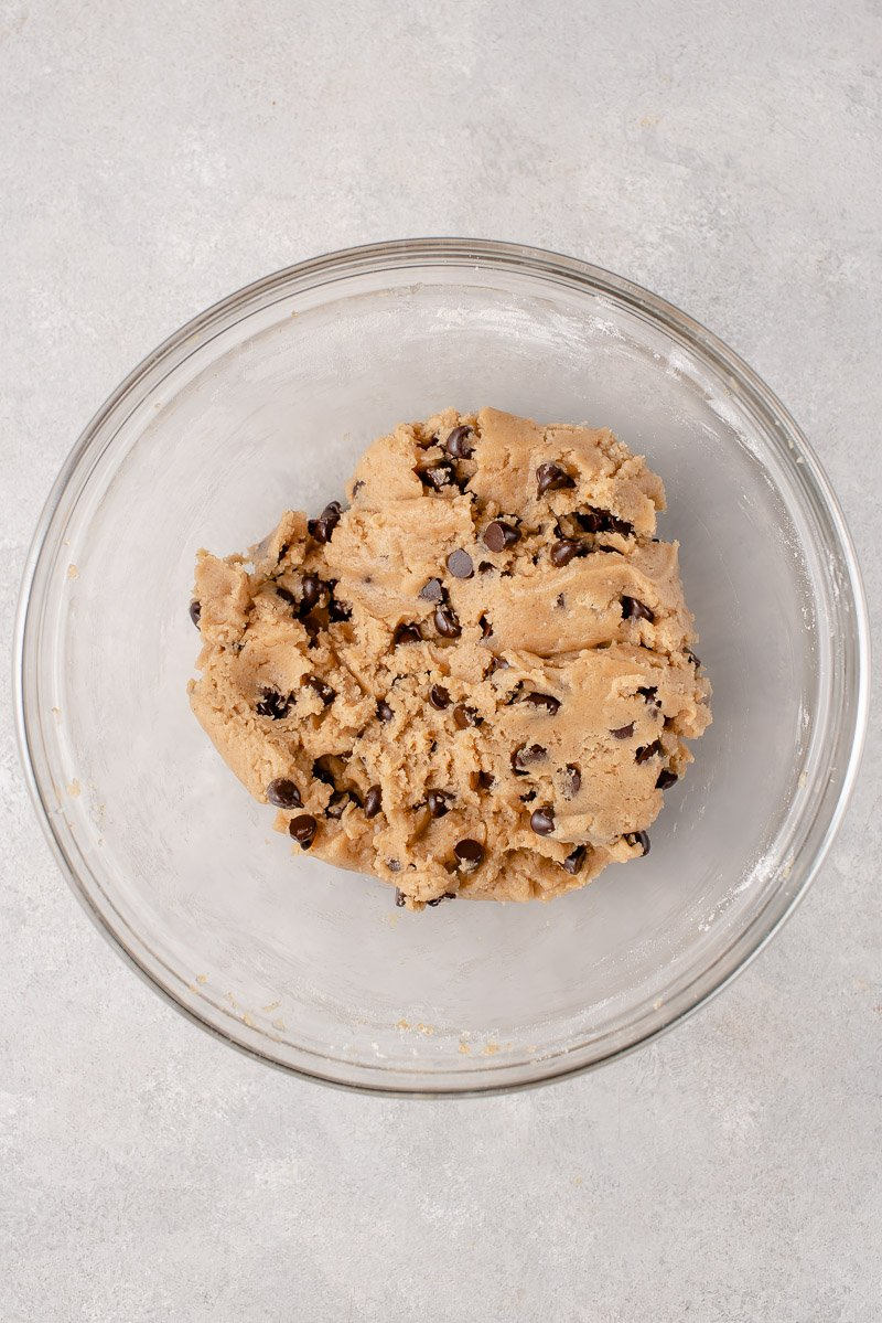 bowl of chocolate chip cookie dough in glass bowl