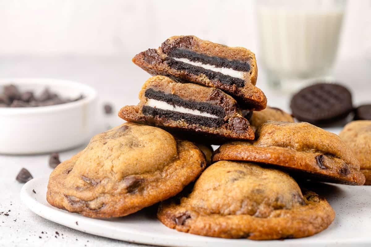 horizontal image of oreo stuffed chocolate chip cookies on a plate