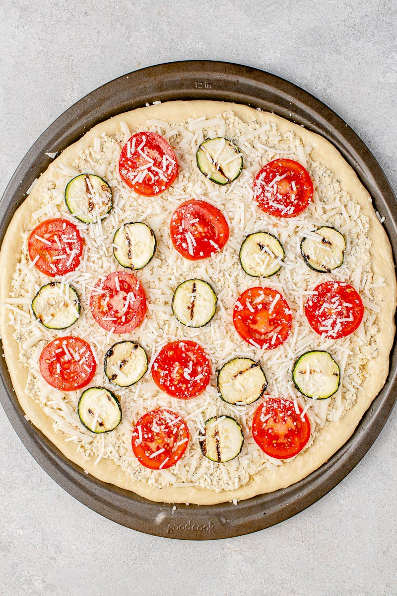 uncooked white pizza on pizza pan