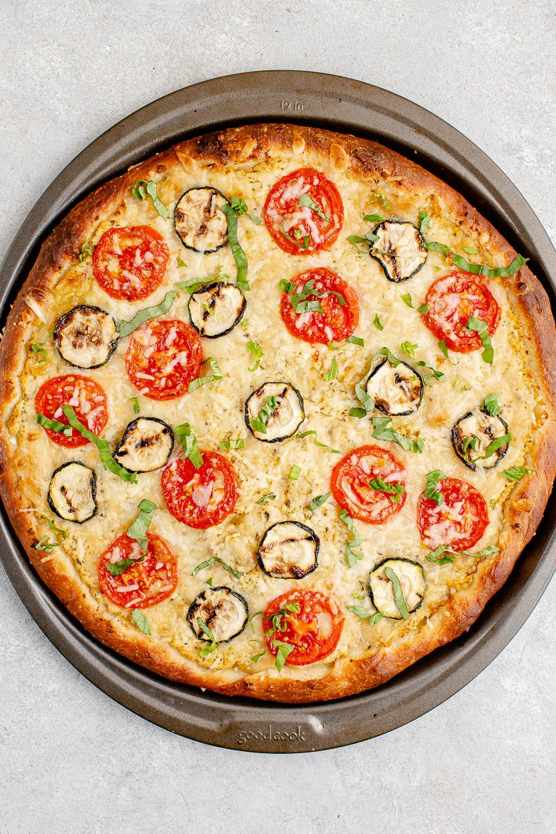 overhead image of white pizza on pizza pan