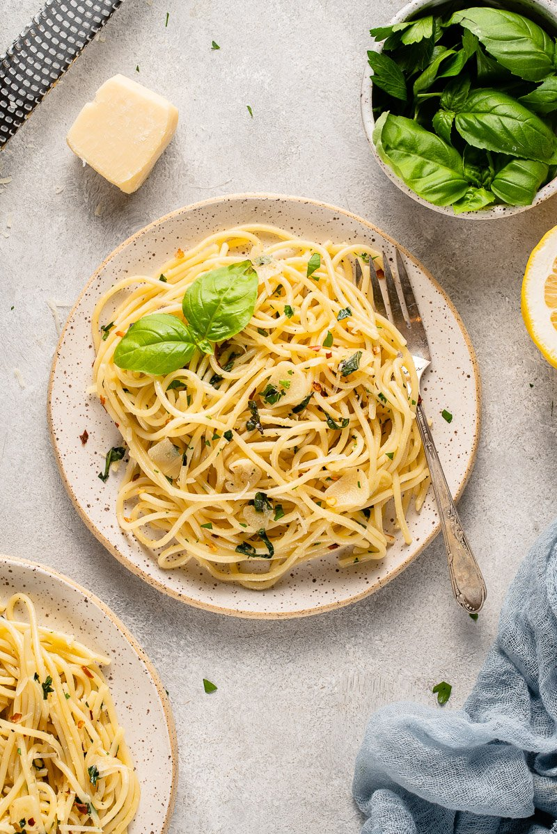garlic and herb pasta on a white plate