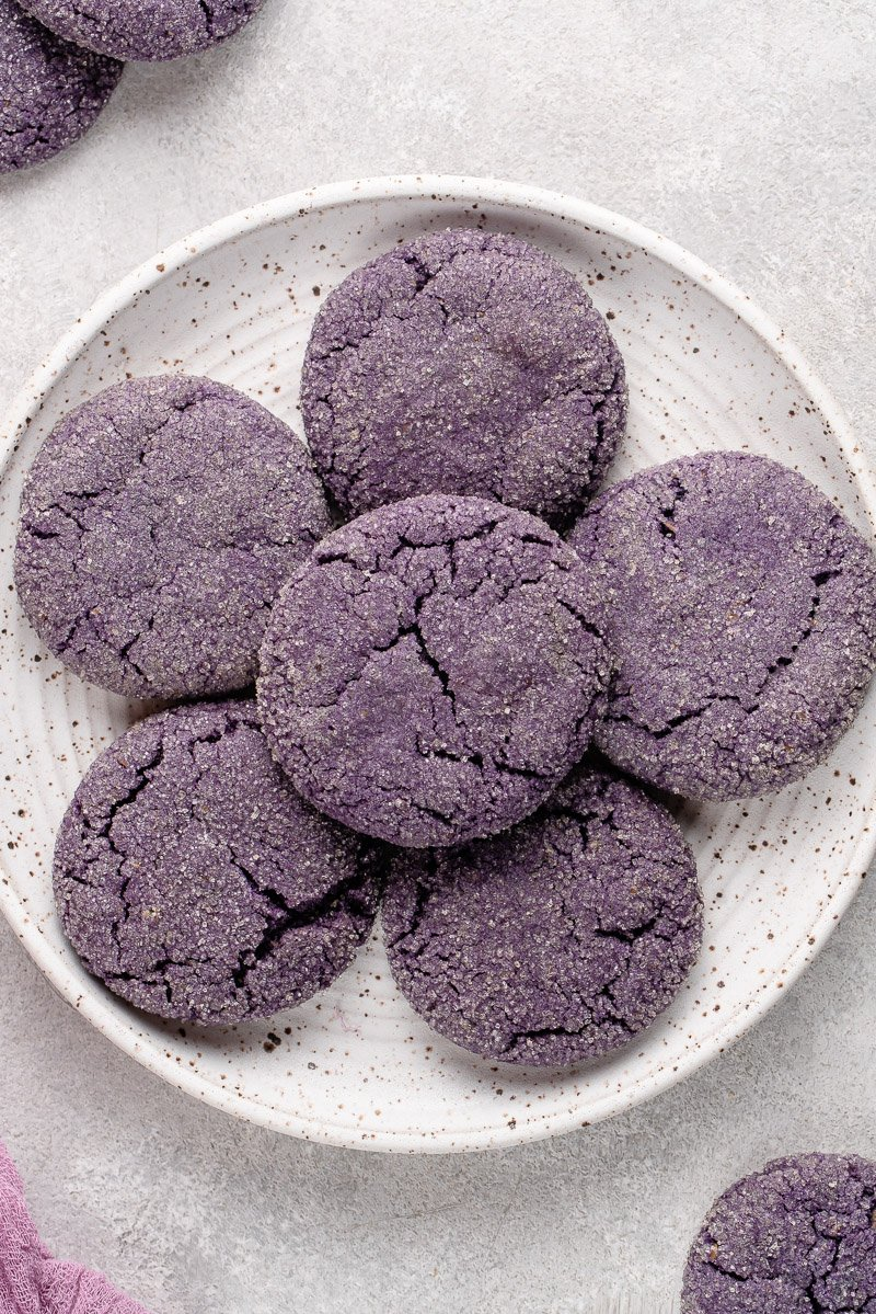 white plate filled with vegan ube sugar cookies