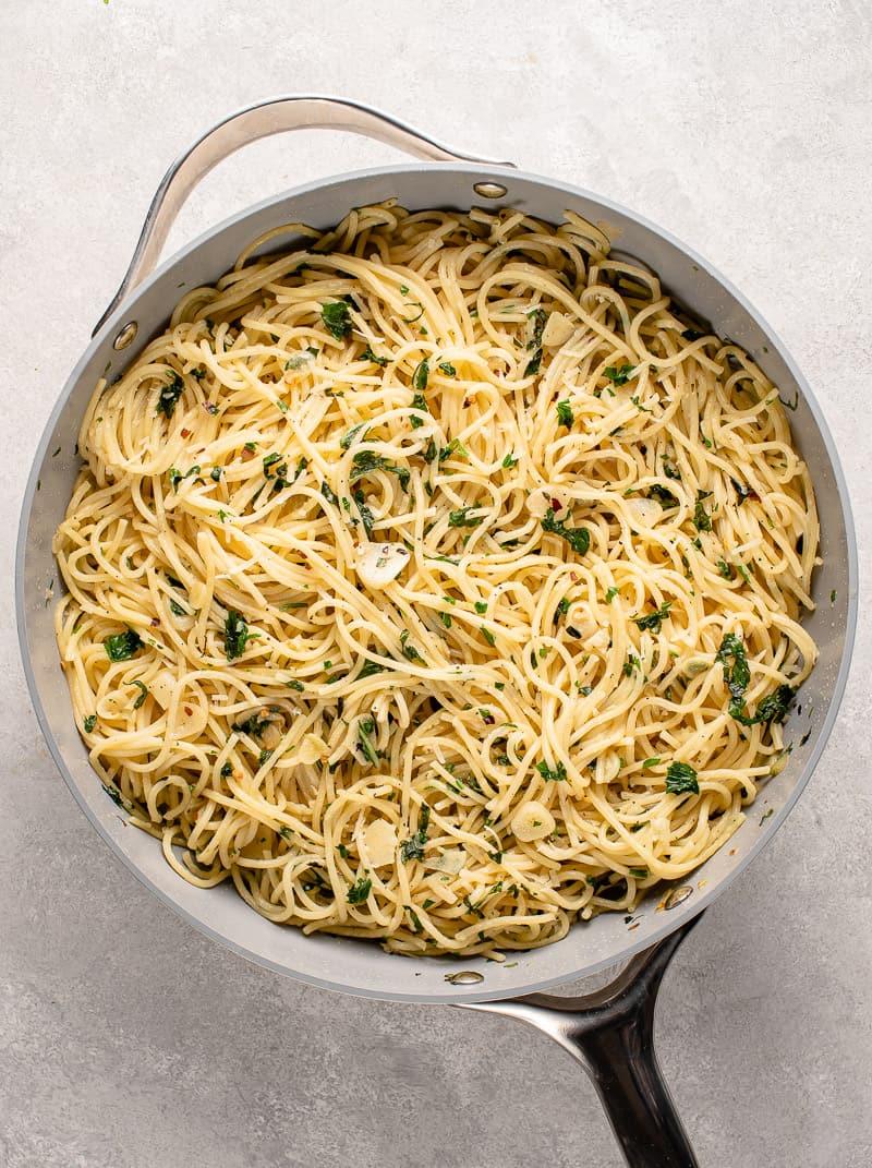 garlic and herb pasta in gray pan