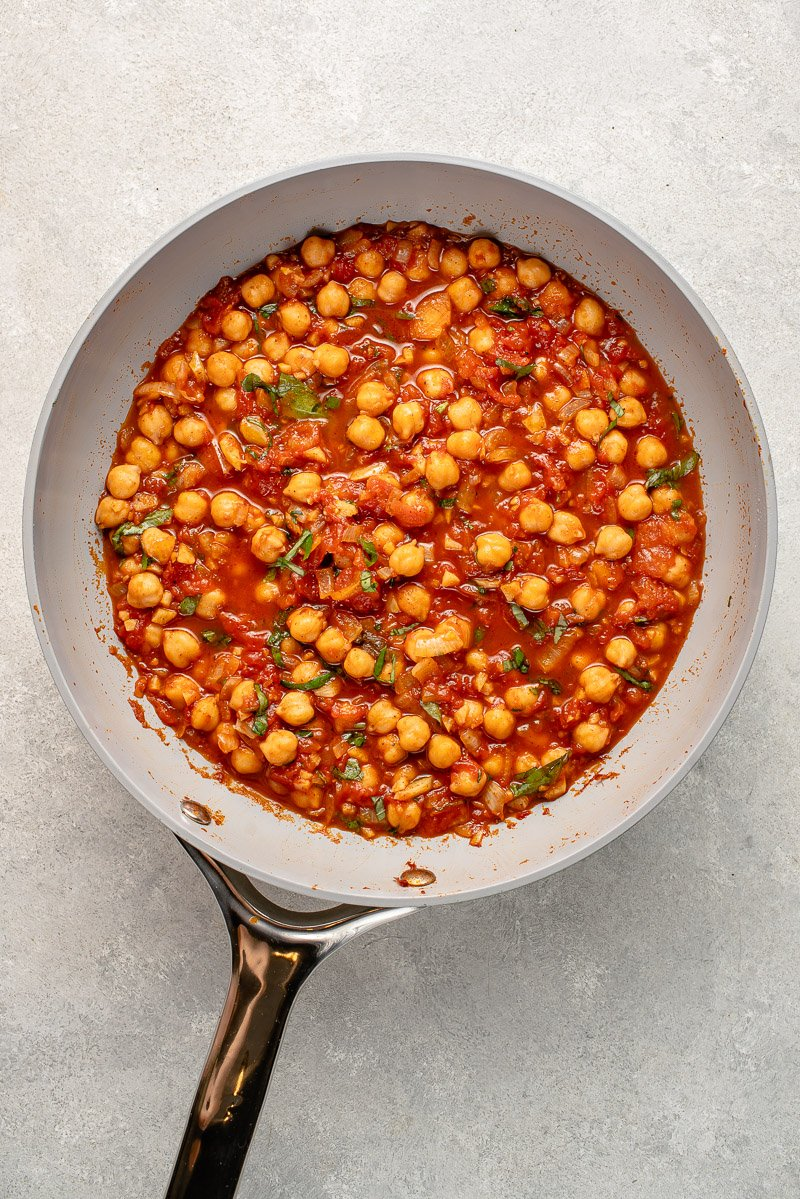 spiced chickpeas and tomatoes in gray pan