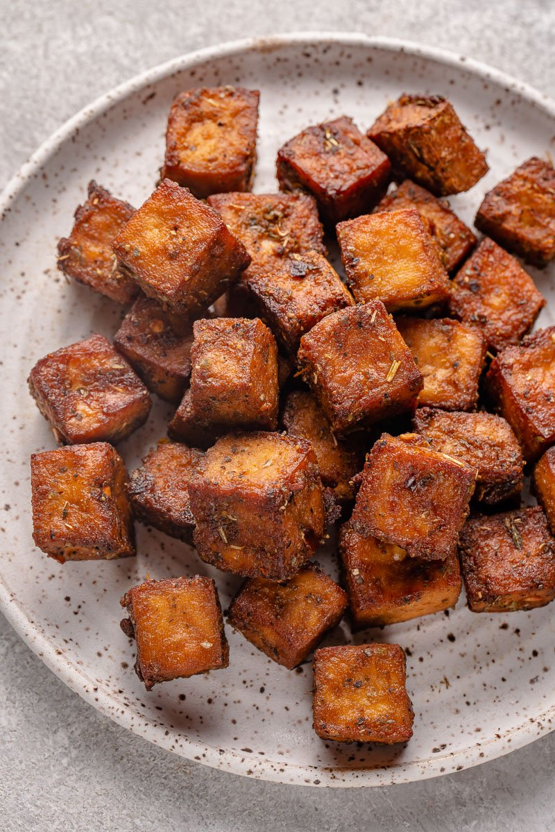 overhead image of herbed tofu on a plate