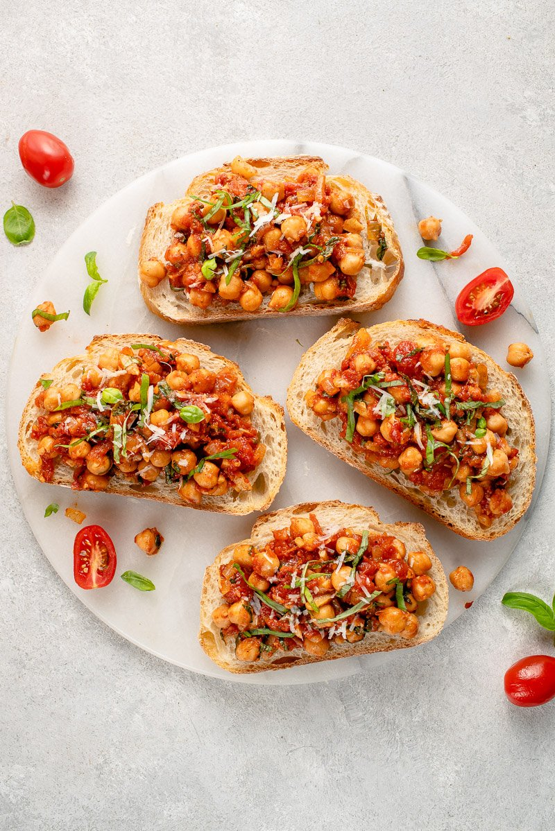 chickpea and tomato toast in marble board