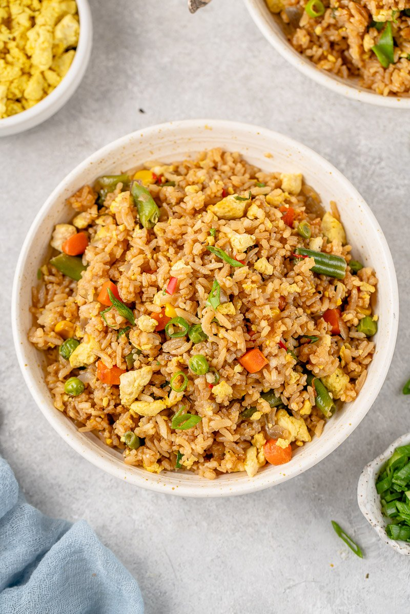 overhead image of vegan egg fried rice in a bowl