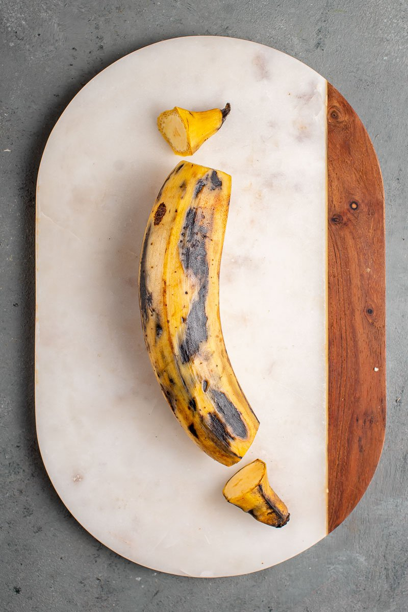 process shot of plantain being peeled