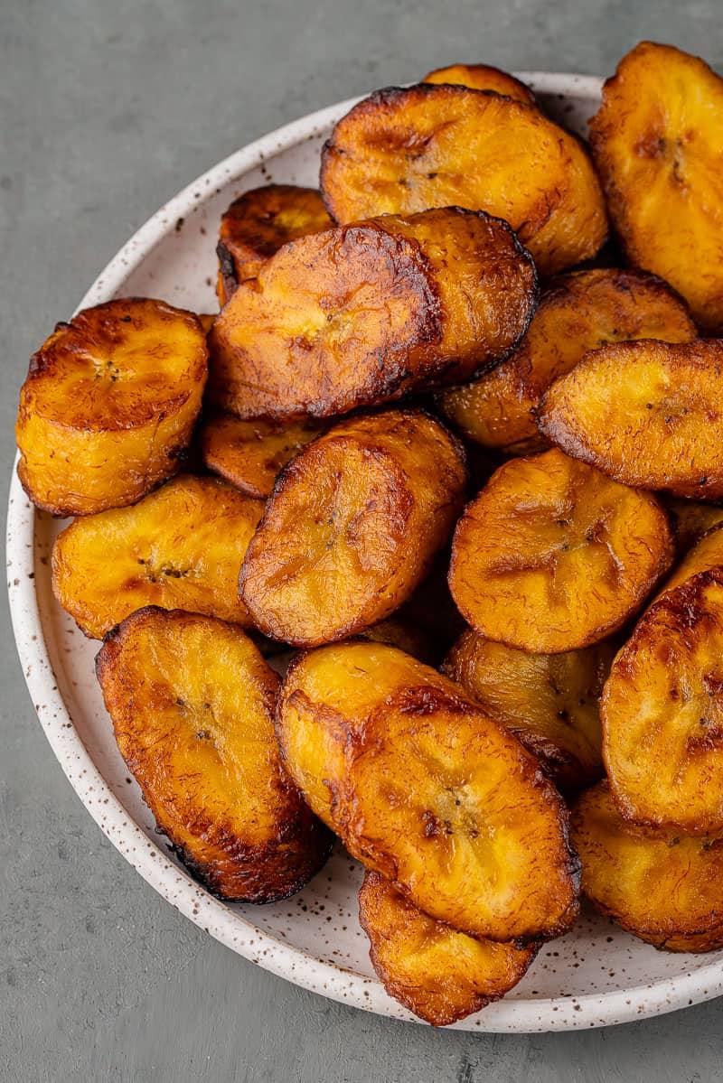 Plátanos Maduros Fritos (Fried Ripe Plantains) on white plate
