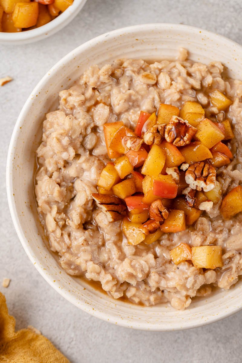 up close image of apple cinnamon oatmeal in a bowl