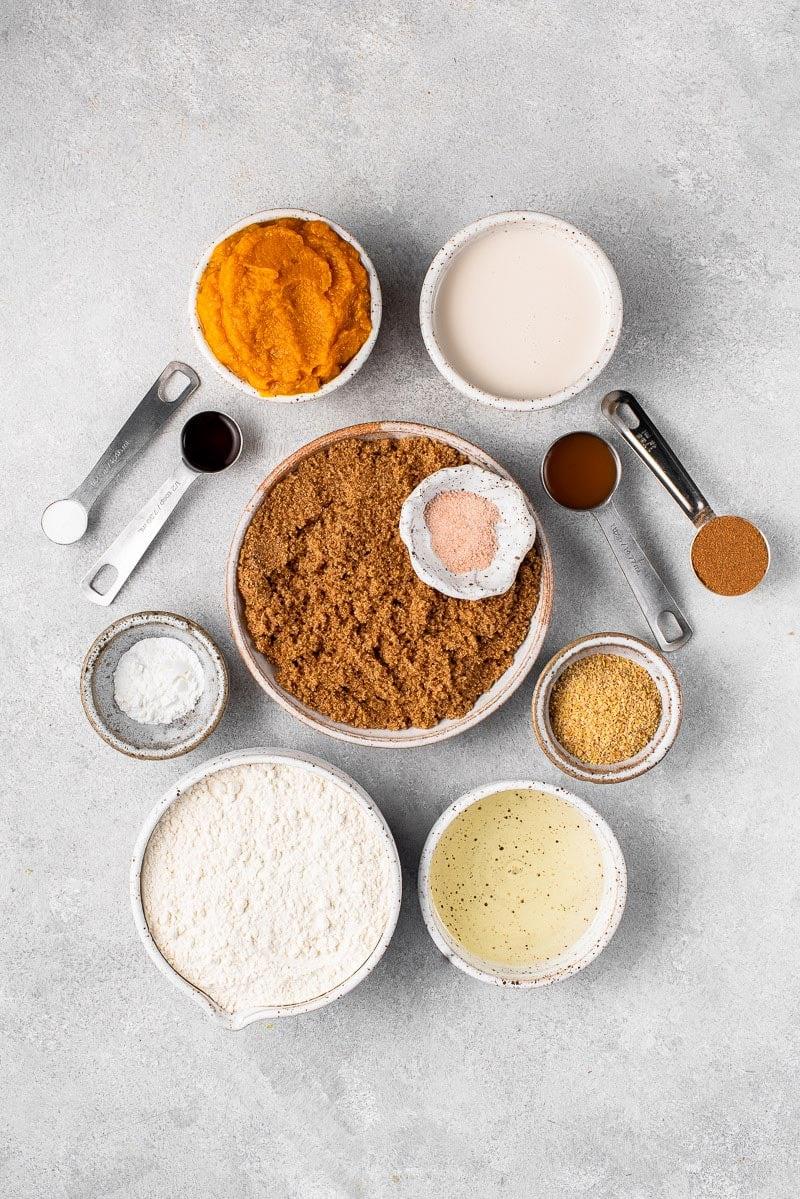ingredients for vegan pumpkin bread on white board