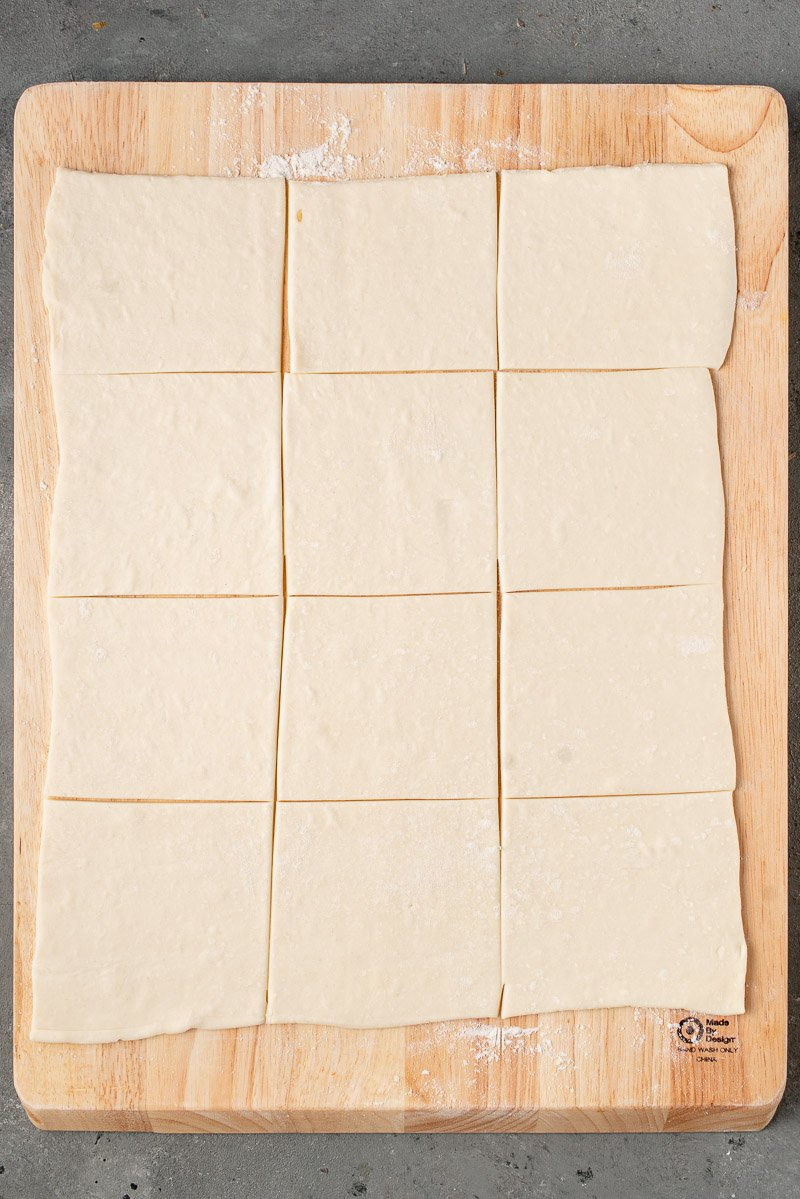 photo of puffed pastry cut into squares